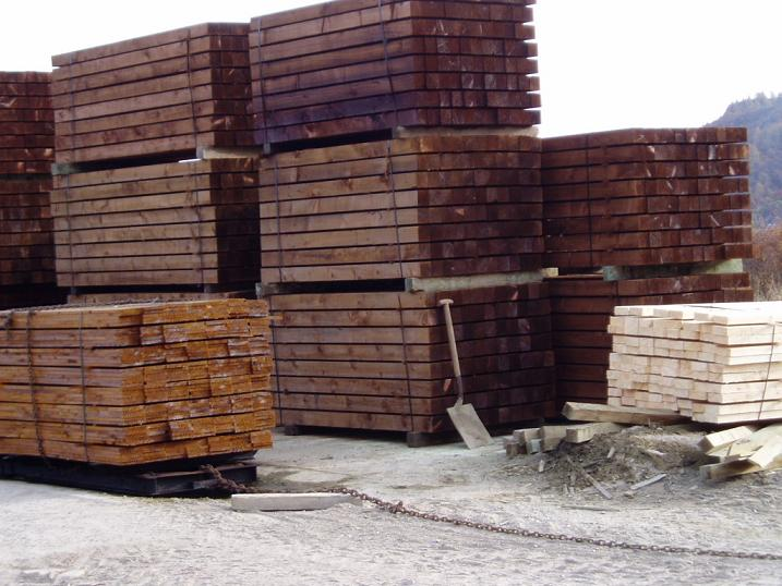 Treated railway sleepers and boards